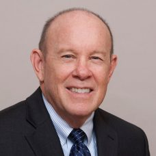 A headshot of M. Edelman from Stanford Federal Credit Union