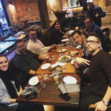 Photo: The Fonolo team poses for a photo while out for a company dinner at a restaurant.